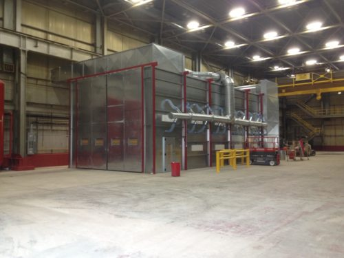 Large paint booth for industrial pipes, tanks and steel structures
