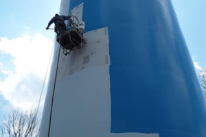 Water tank being painted with Sherwin Williams tileclad coating